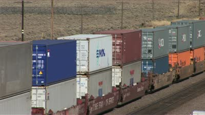 stock-footage-wyoming-usa-circa-october-high-angle-view-of-a-colorful-freight-train-rolling-down-the